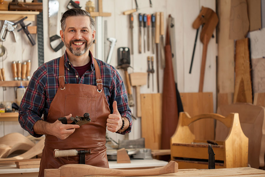 Business Insurance - Portrait Of Happy Carpenter